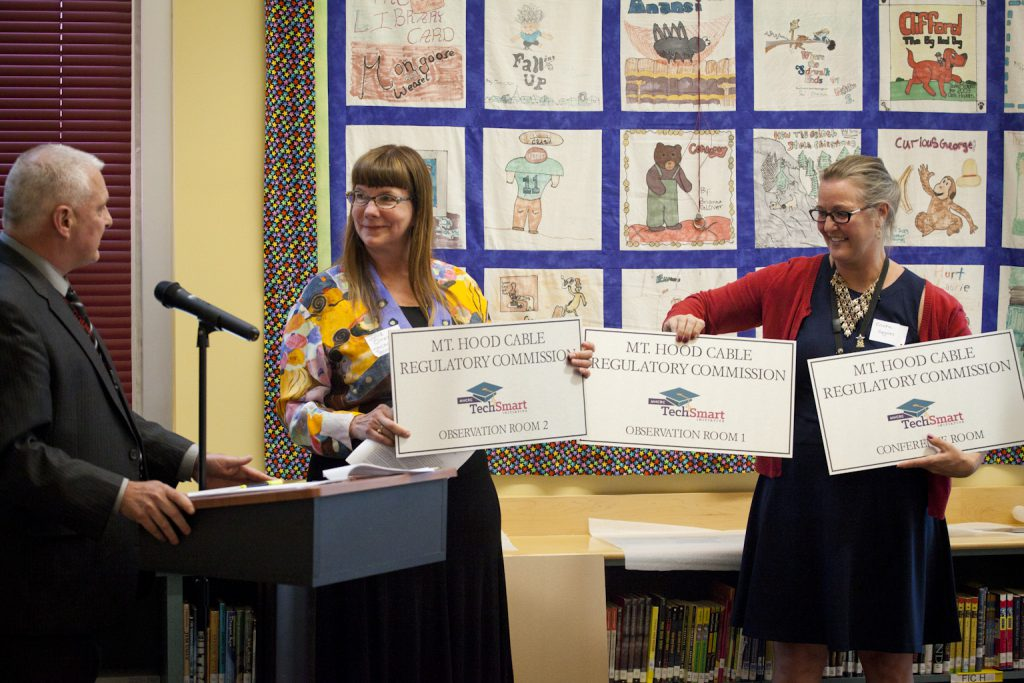 Pictured: DDSD Superintendent Don Grotting, MHCRC staff Julie S. Omelchuck and Earl Boyles Principal Ericka Guynes.