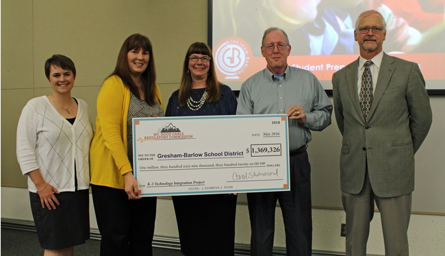 "Presentation of ""big check"" to school district"
